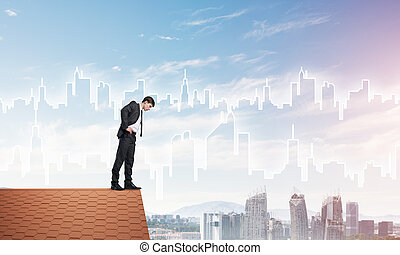 Businessman looking down from roof and modern cityscape at background. Mixed media