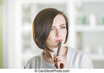 Attractive woman portrait with pen - Close up portrait of...
