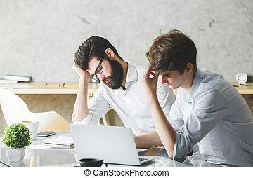 Handsome tired men at work - Handsome tired businessmen at...