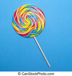 Vibrant Rainbow Lolly Pop on a Blue Background.