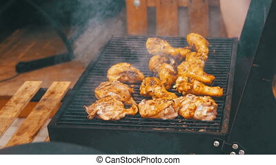 Chicken Meat Cooking on a Barbecue Grill - Grilled chicken...