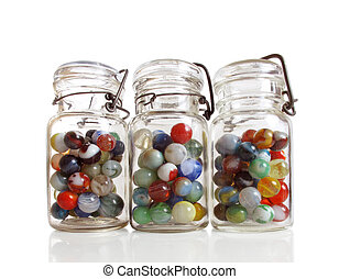 Three jars of marbles - Three old jars contain a collection...