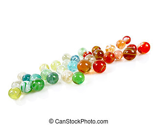 Marbles - Colorful antique marbles on a white reflective...