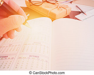 Hand writing blank planning notebook on desk use us organizer schedule life or business planner concept