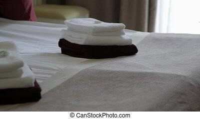 Hotel: Maid making bed in hotel room. Hotel service. female...