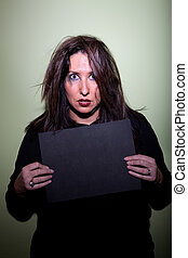 Woman takes mugshot - Deranged looking woman in mugshot with...