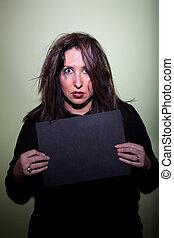 Woman takes mugshot - Deranged looking woman in mugshot with...