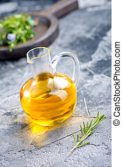 oil - herbal oil in jug and on a table