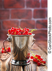 red currant on the wooden table,stock photo