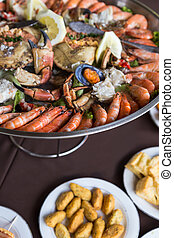 serving plate seafood and crab in big metal dish