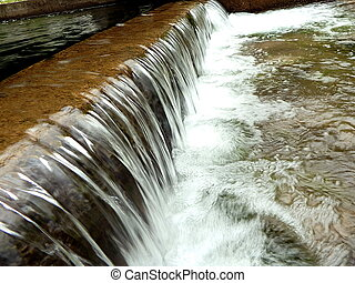 artificial cascade on the river, - small waterfall,...