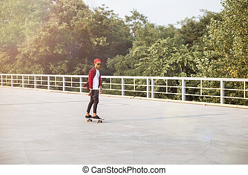 Young dark skinned boy skateboarding - Picture of young dark...