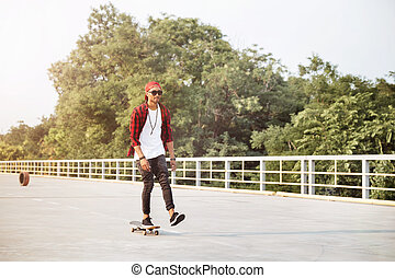 Young attractive dark skinned guy skateboarding - Picture of...