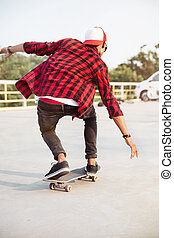 Young dark skinned guy skateboarding - Photo of young dark...