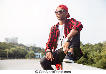 Attractive dark skinned man wearing sunglasses - Picture of...