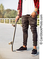 Young dark skinned man holding the skateboard - Picture of...