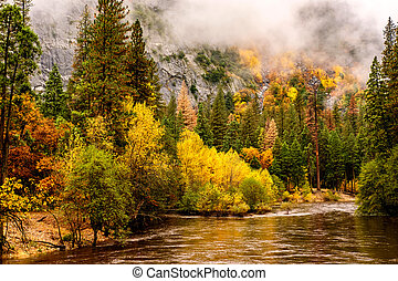 Yosemite National Park Valley and Merced River at autumn....