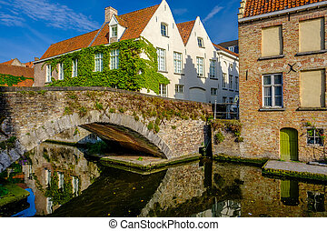 Bruges (Brugge) cityscape with water canal and bridge,...