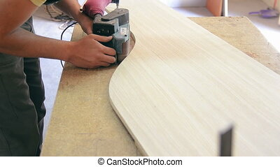 Production of cabinet furniture - carpenter processes a...