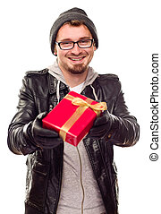 Warmly Dressed Young Man Handing Wrapped Gift Out