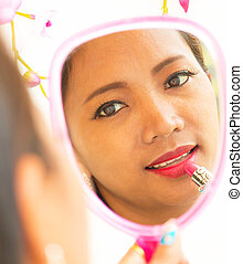 Applying Lipstick In Mirror Shows Beauty And Makeup