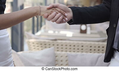 close-up of business partners handshake in honor of the...