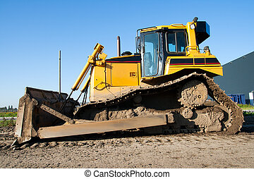 Bulldozer - Yellow bulldozer on a clear blue day