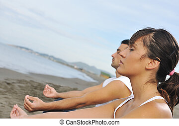 couple yoga beach - young couple people meditating yoga in...