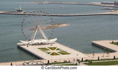 Panoramic view of the Ferris wheel revolves near the sea,...
