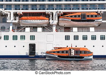 Several lifeboats on large cruiser - Several lifeboats on...