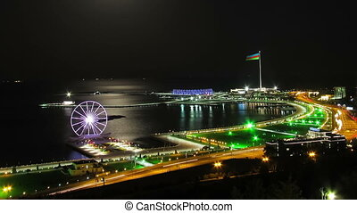 Top View of a Big City at Night, Ferris Wheel on the...