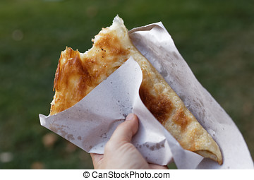 Eating banitsa outdoors
