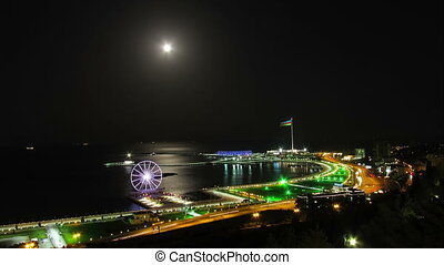 Ferris Wheel on the Background of the Sea and the Lunar...