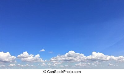 Blue sky with white fluffy clouds