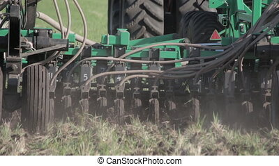 tractor plowing the land plow. close-up