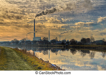 View to power plant across a channel - View to a power plant...