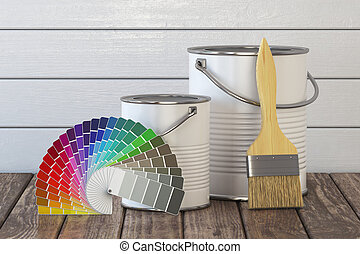 Paint cans, paint brush and color palette on wood table.
