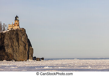 Split Rock Lighthouse and frozen Lake Superior. Minnestota,...