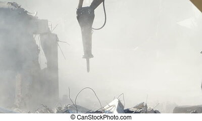 Dust on Demolishing Site - Debris dust is on the air of a...