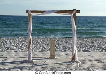 Beach Wedding Arch - Wedding archway with a glass jar on a...