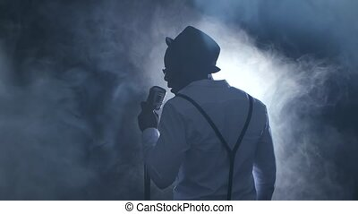 Man singer the view from the back in the smoke and white...
