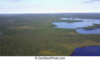 Arial footage of green fileds near a lake Kento in Karelia,...