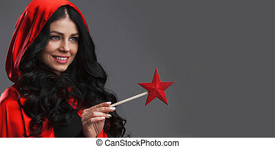 Woman with star shaped magic wand - Gorgeous woman magician...