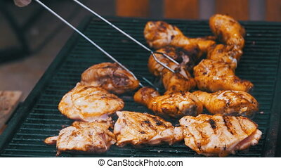 Grilled chicken on the grill. Chicken cooking on a barbeque...