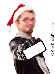 Man with Santa Hat Holding Out Blank Cell Phone