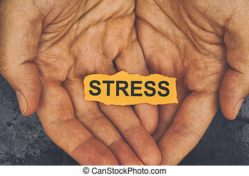 Person holds piece of paper with word Stress