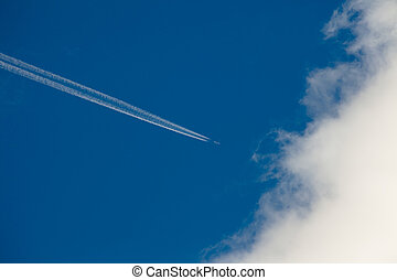 Airplane, condensation path, and cloud - Aircraft leaving...