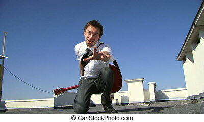 Emotional singer - Male musician with a guitar singing...