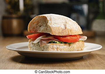 ciabatta sandwich with speck, mozzarella and vegetables,...