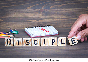 Disciple from wooden letters on wooden background - Disciple...